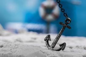 vintage anchor on the beach